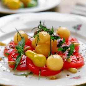 Marinierte Paradeiser mit Melone und Minze